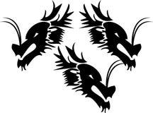 Dragon heads. Tribal vector illustration of dragon head stock illustration