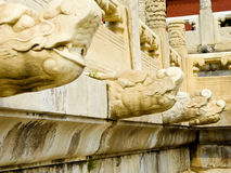 Dragon heads sculpture. White marble railings dragon head statue inside the Imperial Palace in Beijing China Stock Images