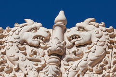 Dragon Heads. Two dragon heads facing a pillar on the top of a building in historical Santa Fe, New Mexico Royalty Free Stock Images