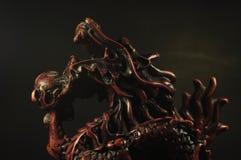 Dragon incense burner on a black background. Royalty Free Stock Images