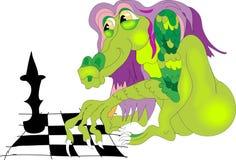 Dragon jouant aux échecs Photos stock