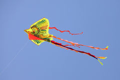 Dragon kite. Flying in a clear blue sky Stock Photo