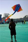 Dragon kite flying at Ahmedabad. A very huge dragon kite flying at International Kite Festival, Ahmedabad celebrated by Govt.of Gujarat Royalty Free Stock Images