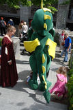 Dragon,  lady and children Stock Image