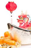 Dragon on large gold ingot and hanging lantern Royalty Free Stock Photos