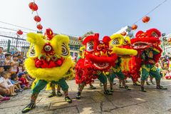 SAIGON, VIETNAM - FEB 15, 2018 - Dragon and lion dance show in chinese new year festival. Dragon and lion dance show in chinese new year festival at Chinatown stock images