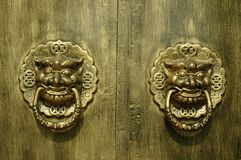 Dragon or Lion Doorway. Dragon or lion door knocker guarding a doorway - chinese metaphor and mythology royalty free stock photo