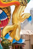 Dragon or monster paw. Golden dragon claw dragon foot statue stock photo
