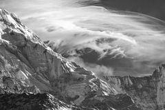 The Dragon on the mountain. A wispy white cloud resembles the form of a Dragon behind the Annapurna mountain range in the Himalayas, Nepal, Asia royalty free stock photos