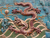 Dragon mural 6. Different colored ancient tiled gragons on a wall of eight dragons. This is one of them. Every dragon has a different pose Royalty Free Stock Photo