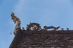 Dragon on oriental temple roof Stock Photos