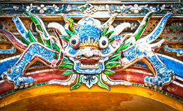 Dragon over gate to Hue citadel. Vietnam, Asia. Stock Images