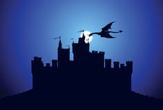 Dragon over the medieval castle Stock Images