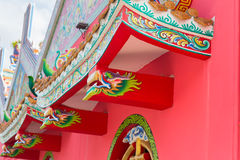 Dragon paint by oil color on public shrine roof, Thailand, Dragon prominently. In the beautiful on blue sky background stock image