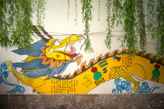 Dragon painting on a wall in Lijiang old town. Stock Photo