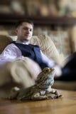 Dragon Pet et propriétaires barbus Photographie stock