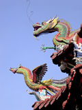 Dragon and Phoenix. Guard the top of this temple in Taiwan stock photography
