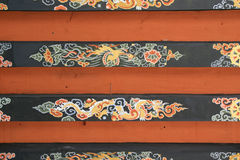 A dragon, a phoenix and diverse patterns are painted on the ceiling of a temple (Bhutan) Royalty Free Stock Image