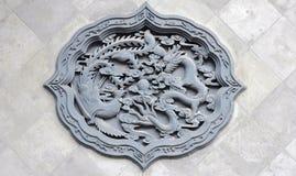 Dragon and phoenix emblems Royalty Free Stock Image