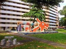 Dragon playground - Singapore. Old dragon playground in front of a HDB apartment block in Toa Payoh, Singapore Royalty Free Stock Photography