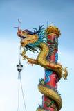 Dragon pole climbing Royalty Free Stock Photo