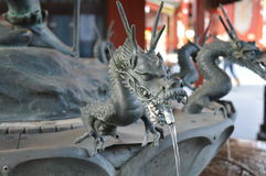 Dragon purification. Before one is permitted to enter the temple, they must first be purified by the water dragon Royalty Free Stock Images