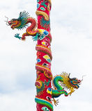 Dragon red and green on high poles Royalty Free Stock Photos