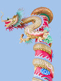 Dragon. A replica of Chinese dragon creeping and spiralling over a long pole. It soared skyward Royalty Free Stock Photo
