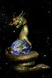 Dragon rolled the earth in the space Royalty Free Stock Photography