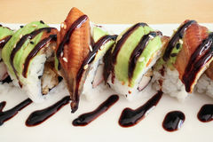 Dragon Rolls. Contain of unagi, avocado, rice and sauce Royalty Free Stock Photo