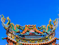 Dragon on roof at chinese temple. Thailand Stock Images