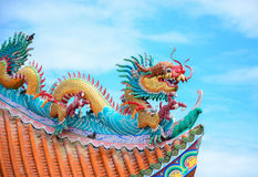Dragon on the roof of the shrine. Golden dragons on the roof of a Chinese temple Royalty Free Stock Photography