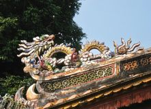 Dragon on the roof of a temple in Vietnam stock photography