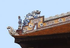 Dragon on a temple roof. Dragon on a roof of a Vietnamese temple royalty free stock photo