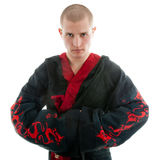 Dragon samurai on white. Man dressed in black dragon kimono demonstrating martial arts combat Stock Photo