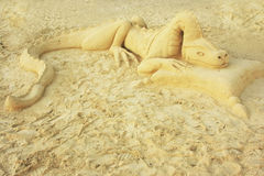Dragon sand sculpture on a beach Stock Photos