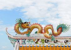 Dragon sculpture on a Chinese temple roof. Royalty Free Stock Photo