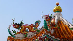 Dragon Sculpture climbing on the roof Royalty Free Stock Images