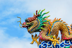 Dragon sculpture. Close up shot of Dragon sculpture with the blue sky Stock Image
