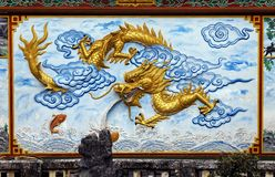 Dragon decoration of a temple in Vietnam stock images