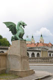 Dragon sculpture on Dragon Bridge view  Cathedral Saint Nicholas Royalty Free Stock Photos