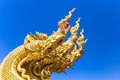Dragon sculpture at entrance to temple Stock Photos