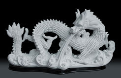 Dragon sculpture. Isolated on black background, image include clipping path for remove background Royalty Free Stock Image