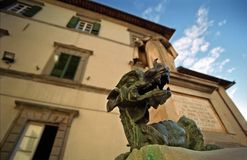Dragon sculpture in Italy. Dragon sculpture in Cortona, Italy Royalty Free Stock Photo