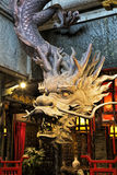 Dragon sculpture made of wood in Kuanzhai Alleys, Chengdu, China. Chengdu China, March 31, 2017 Dragon sculpture made of wood found along the famous Kuanzhai Stock Photos