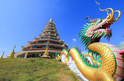 Dragon sculpture and the pagoda at Wat Huay Pla Kang. Wat huay Pla kang is located in Mueang Chiang Rai District,Chiang Rai,Thailand Stock Photo