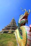 Dragon sculpture and the pagoda at Wat Huay Pla Kang. Wat huay Pla kang is located in Mueang Chiang Rai District,Chiang Rai,Thailand Royalty Free Stock Photo