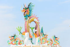 Dragon sculpture on platform against blue sky Stock Photo
