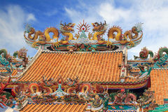 Dragon sculpture on roof in joss house Stock Photos