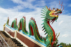 Dragon sculpture on staircase rail. Dragon sculpture on the staircase rail of Wat Muang (Public temple), Angthong, Thailand stock photography